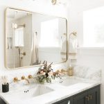 white and gray bathroom dark gray vanity gold hardware