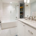 white bathroom remodel with storage in old town fort collins