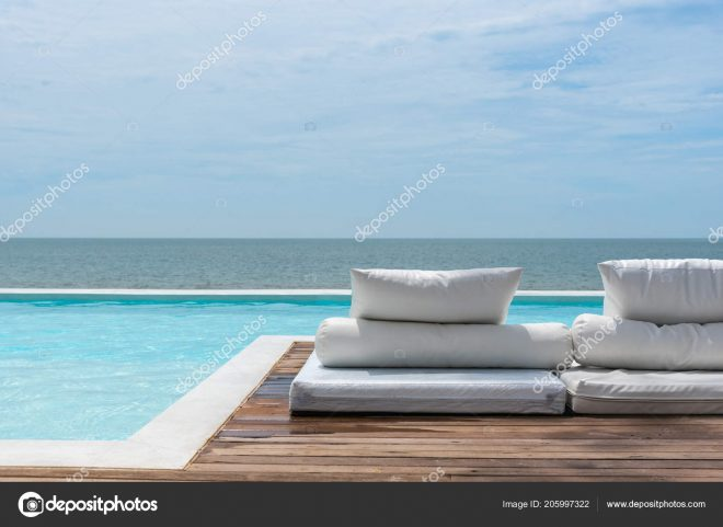 white beach bed outdoor swimming pool seaside turquoise sea