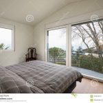 white bedroom large windows stock image image of wood
