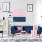 white blue and pink living room interior with couch paintings