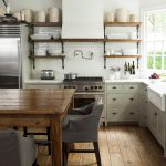 white kitchen with exposed beams open shelves farm table