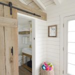 whitewashed wood panels cover the walls and ceiling of this