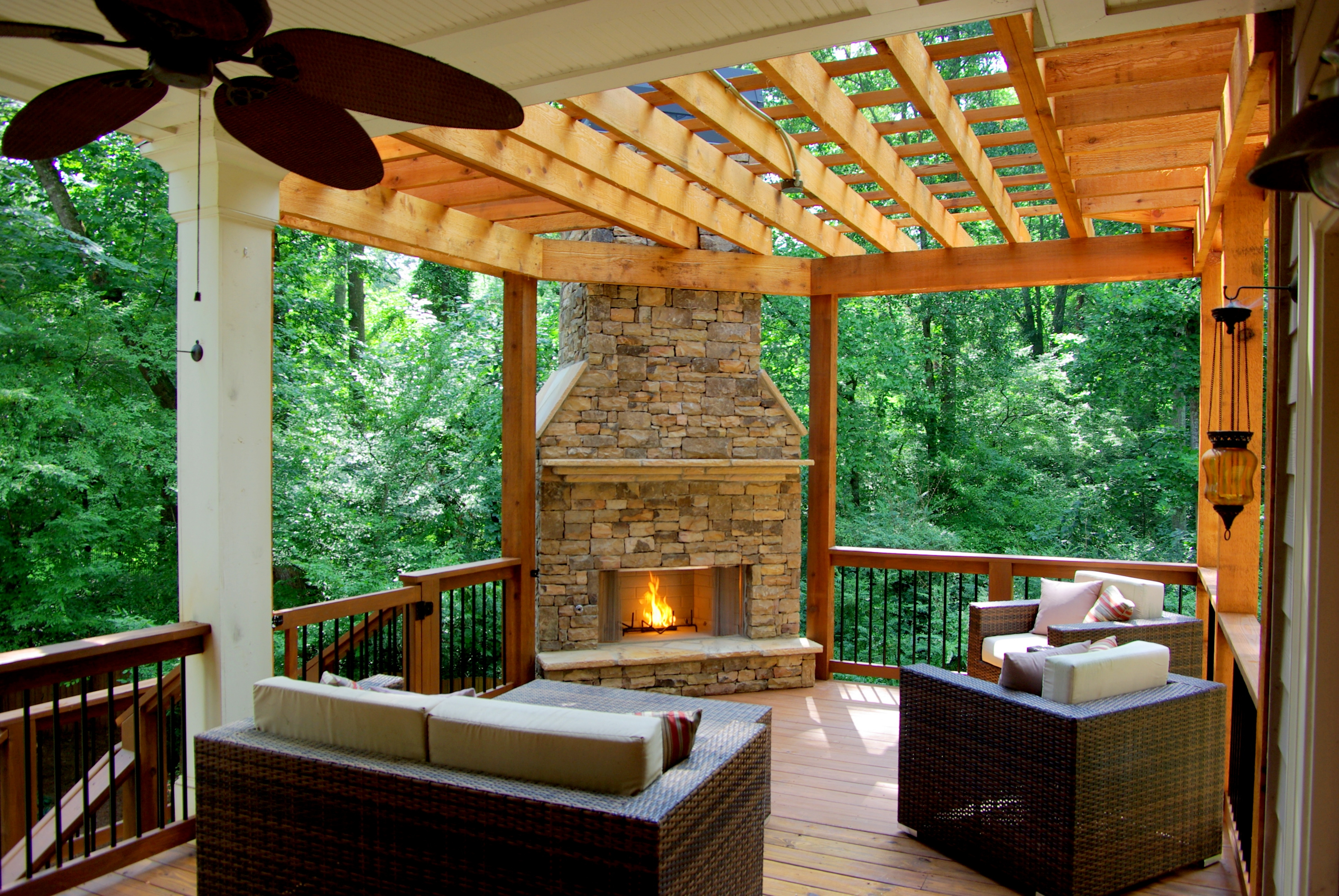 why you should add an outdoor fireplace or pit to your deck patio