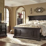 willenburg casual dark brown solid wood master bedroom set