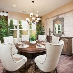 wingback chairs at dining table in house d145201386