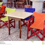yellow blue and orange wooden armchairs outdoor stock image